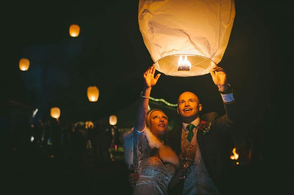 Bride and groom releasing a lantern by Abi Riley Photography