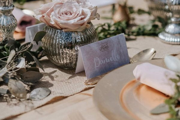 A photograph of wedding stationery - a table setting. A unique wedding stationery design