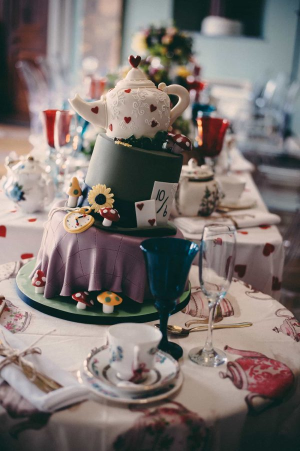 A photograph of a decadent wedding cake inspired by Alice in Wonderland. The beauty of wedding cakes