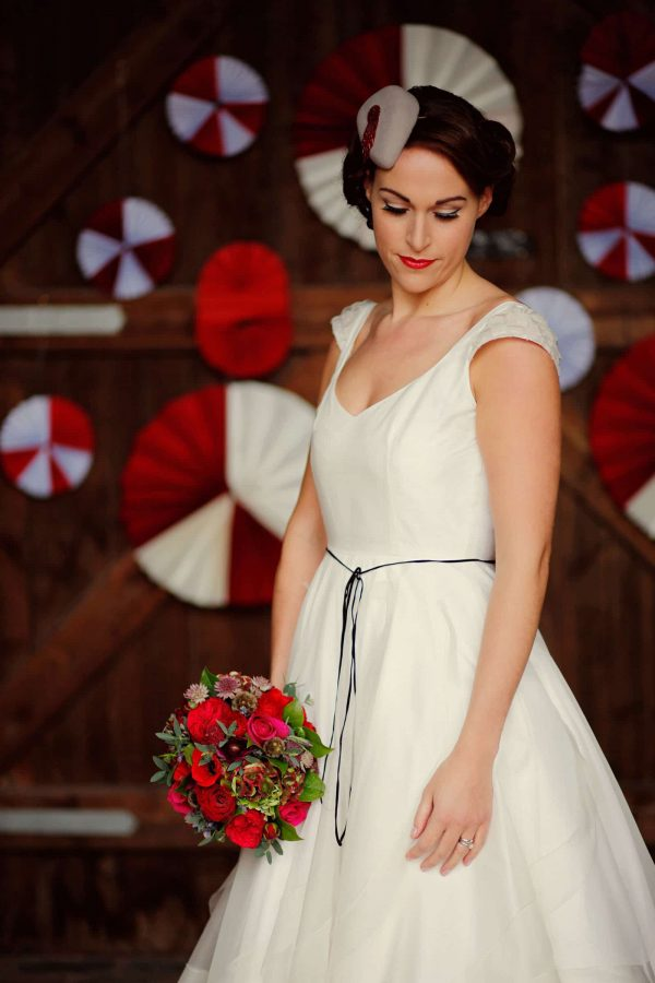 A photograph of a bride in a wedding gown by Sarah Treble Couture as featured on eeek! Weddings. Handmade wedding dress