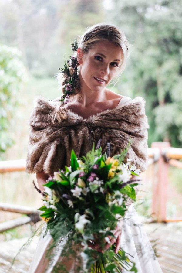 Model for photoshoot holding a beautiful wedding bouquet by Olivia Bossert Photography
