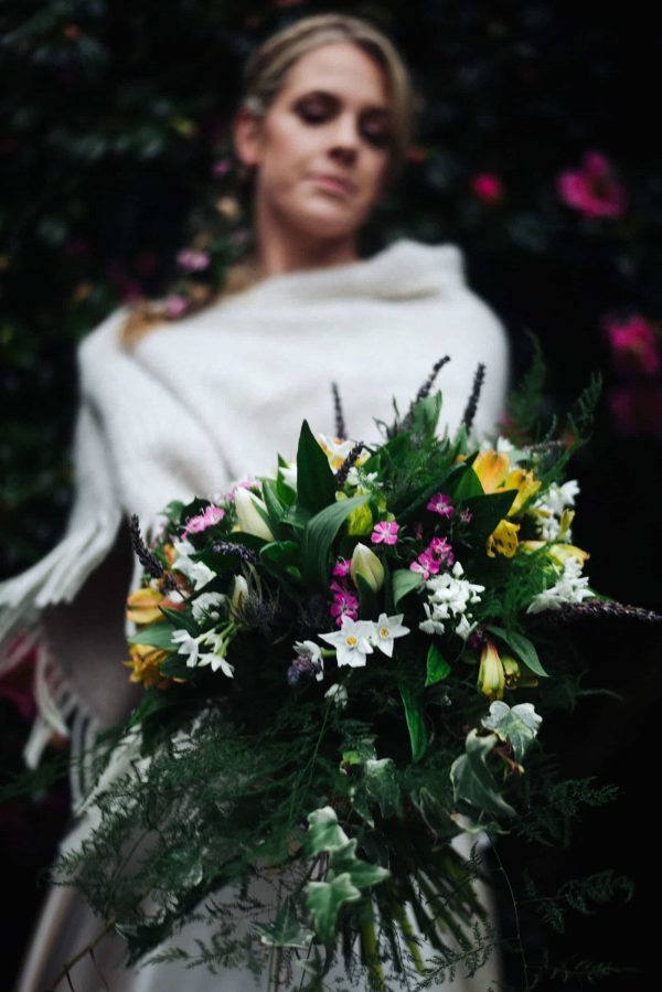 Bride holding a large rustic beautiful bouquet by Olivia Bossert Photography