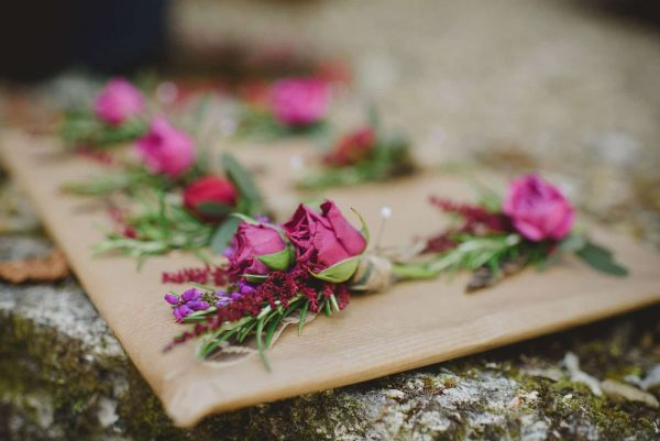 A photograph of beautiful pink buttonholes by Loulabel. Imperfectly perfect flowers as featured on eeek! weddings