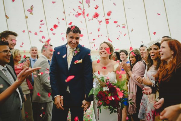 Bride groom and confetti by Keith Riley Photography
