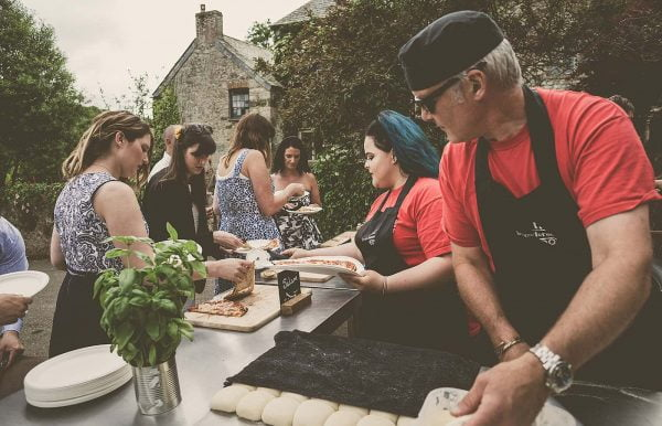 Kerno Frono making delicious pizzas for a wedding feast as featured on eeek! weddings