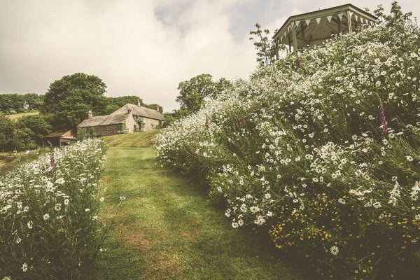 A photograph of a manor, a laid-back manor wedding