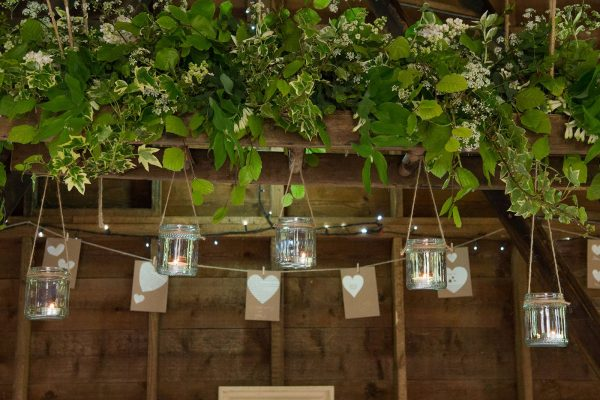 Flowers, foliage and herbs arranged for a barn wedding