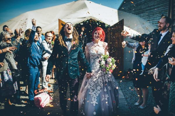 Bride and groom and confetti by Toby Lowe Photography