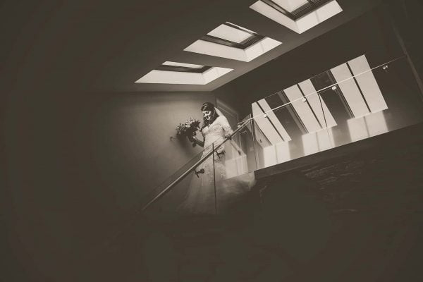 Bride walking down steps by Tracey Warbey Photography