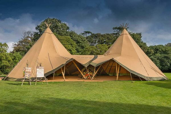 A wedding tipi tent in an open field from The Cornish Tent Co. as featured on eeek! weddings