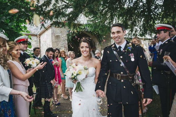 Newly weds leaving church as Mr and Mrs, a romantic Cornish wedding