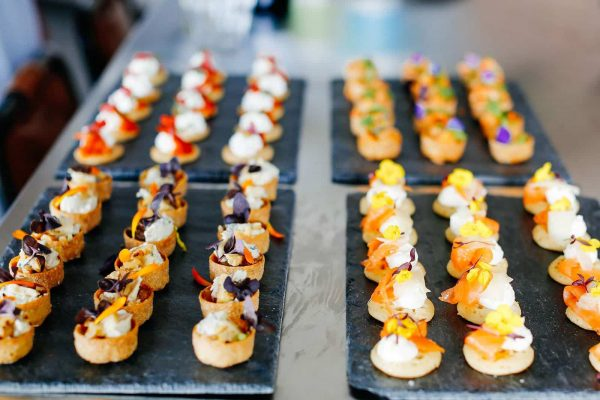 Delicious canapes on a slate plate by Indulgence catering as featured on eeek! weddings