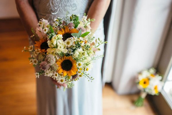 A photograph of a bride holding a bouquet beautiful flower styling by Sharon Mesher