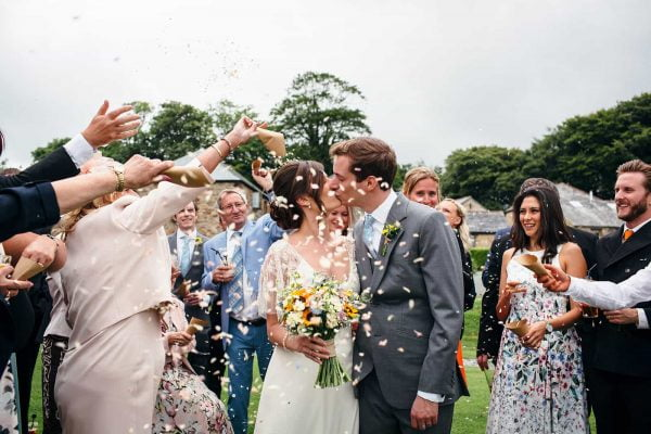 Newly weds and confetti by Freckle Photography