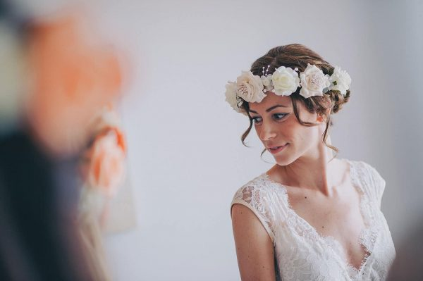 Bride looking at herself in a mirror by Nick Walker Photography