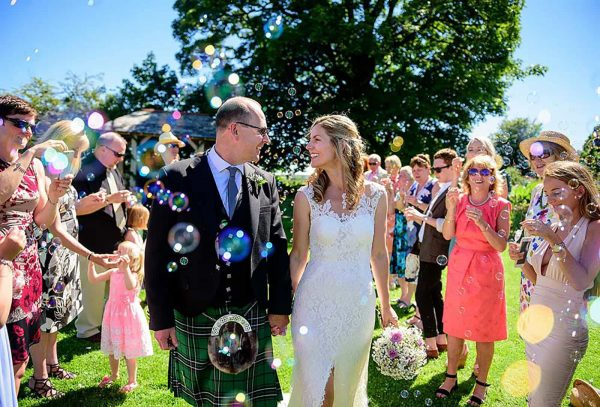 Newly weds and bubbles by Paul Keppel Photography