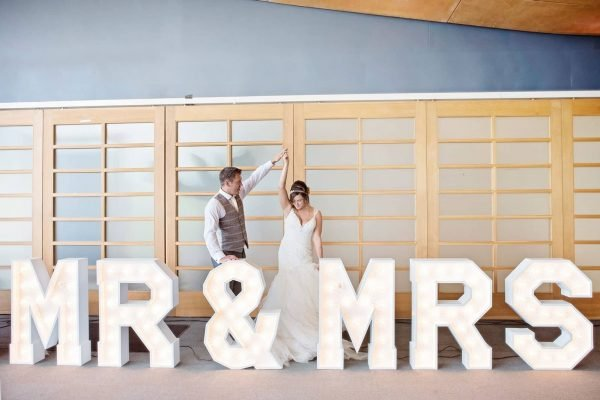 Newly weds dancing next to Mr and Mrs Letter Lights from Say it with Lights as featured on eeek! weddings