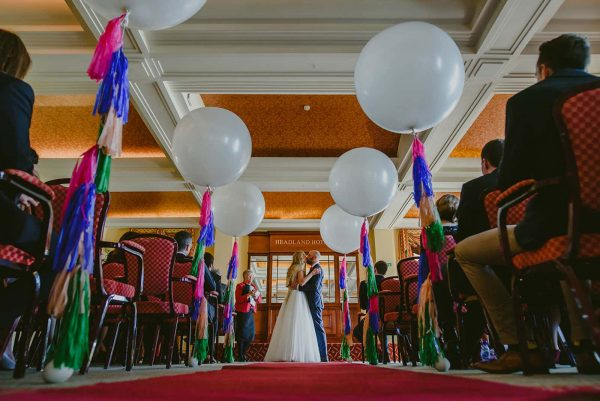 photograph of couple kissing and balloons by Snazzy Balloons on eeek! weddings