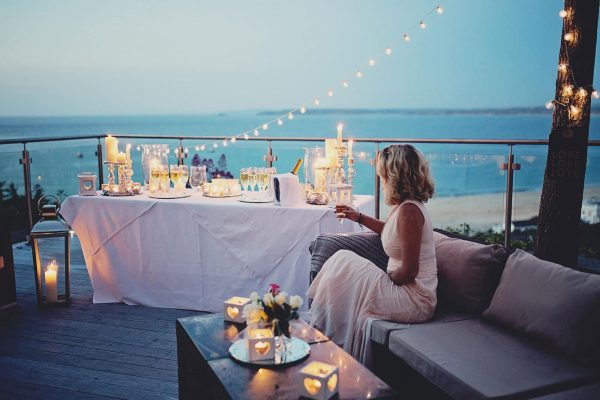 Bride sitting on a balcony looking out to sea at St Ives Harbour Hotel as featured on eeek! weddings