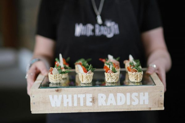 A photograph of delicious canapes by Wihite Raddish Catering featuring on eeek! weddings. Creative wedding dishes