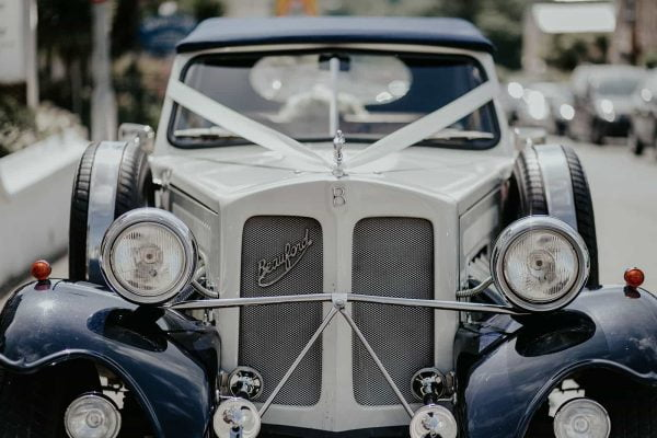 A photograph of a wedding car. Add glamour, style and sheer flamboyance to your day by arriving in style with Treverbyn Cars