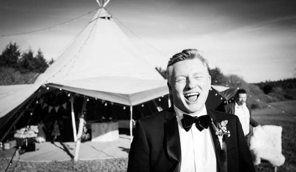Groom laughing by Verity Westcott Photography