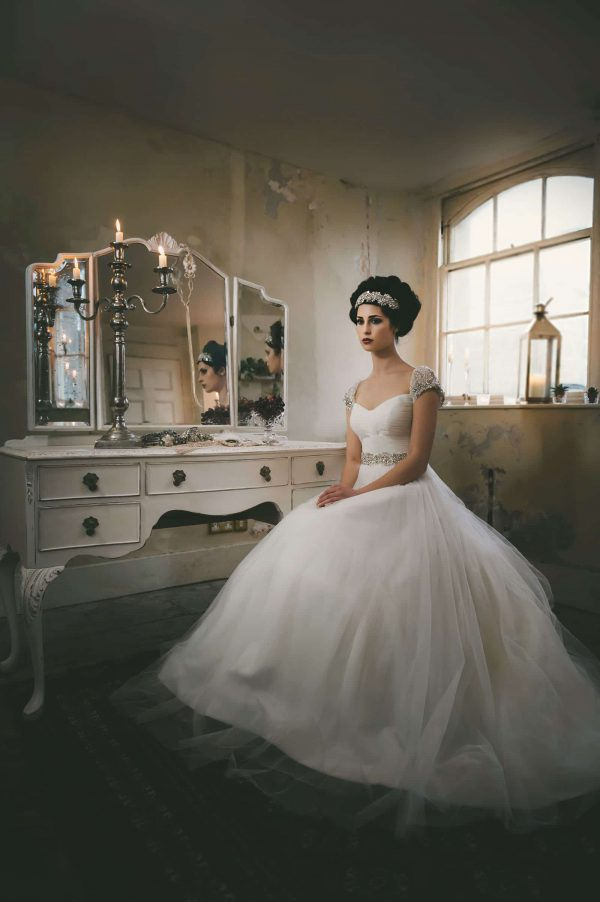 A photograph of a model in a wedding dress. Photo shoot rough luxe elegance