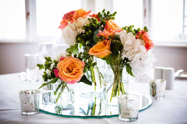 A photograph of beautiful orange wedding flowers from a small, innovative, designer florist
