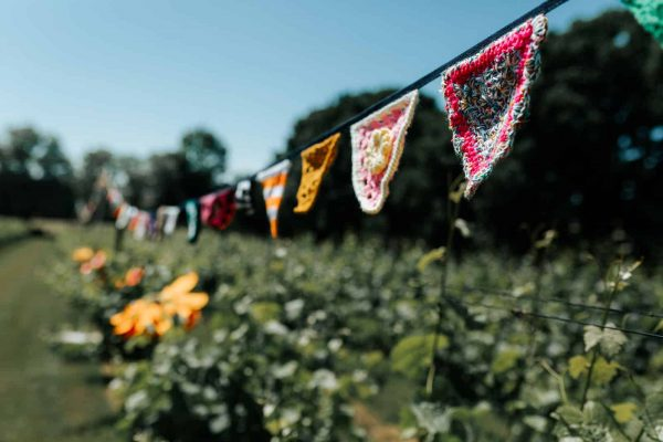 Crochet bunting was used to create a Boho Picnic with a 1970's vibe!