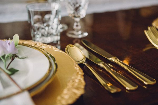 Gold plates, chargers, cutlery and cut glass glasses to create the luxurious feel of the wedding shoot