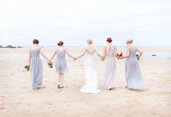 Bride and bridesmaids on a beach