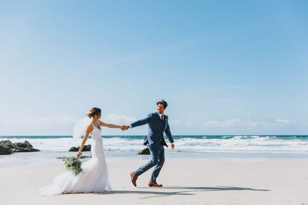 Bride and groom on a beach. Wedding photography by Wild Tide Creative